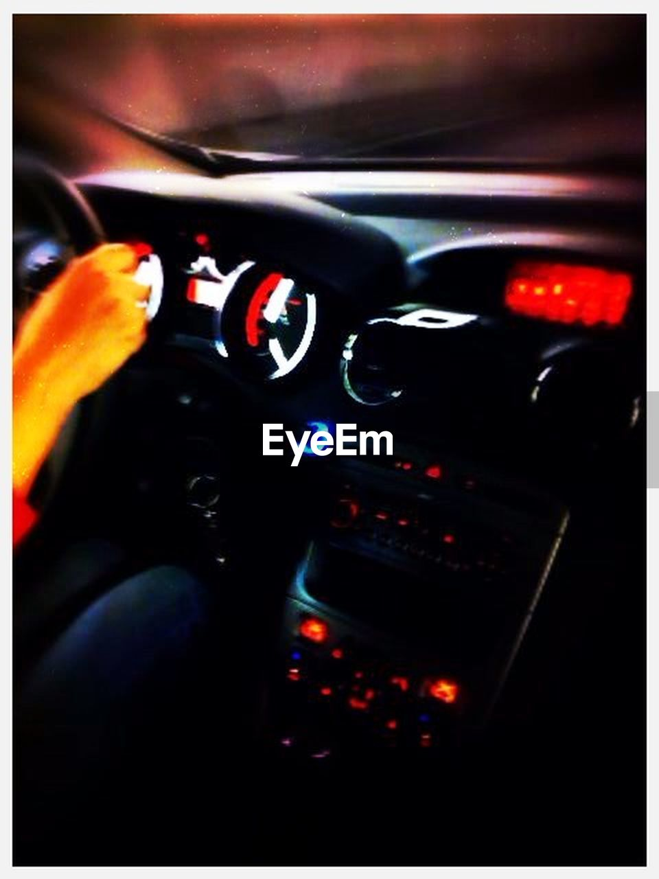 vehicle interior, transportation, car interior, control, dashboard, steering wheel, speedometer, one person, car, mode of transport, control panel, speed, human body part, human hand, close-up, night, cockpit, technology, one man only, illuminated, gauge, people, piloting, adult, outdoors, only men