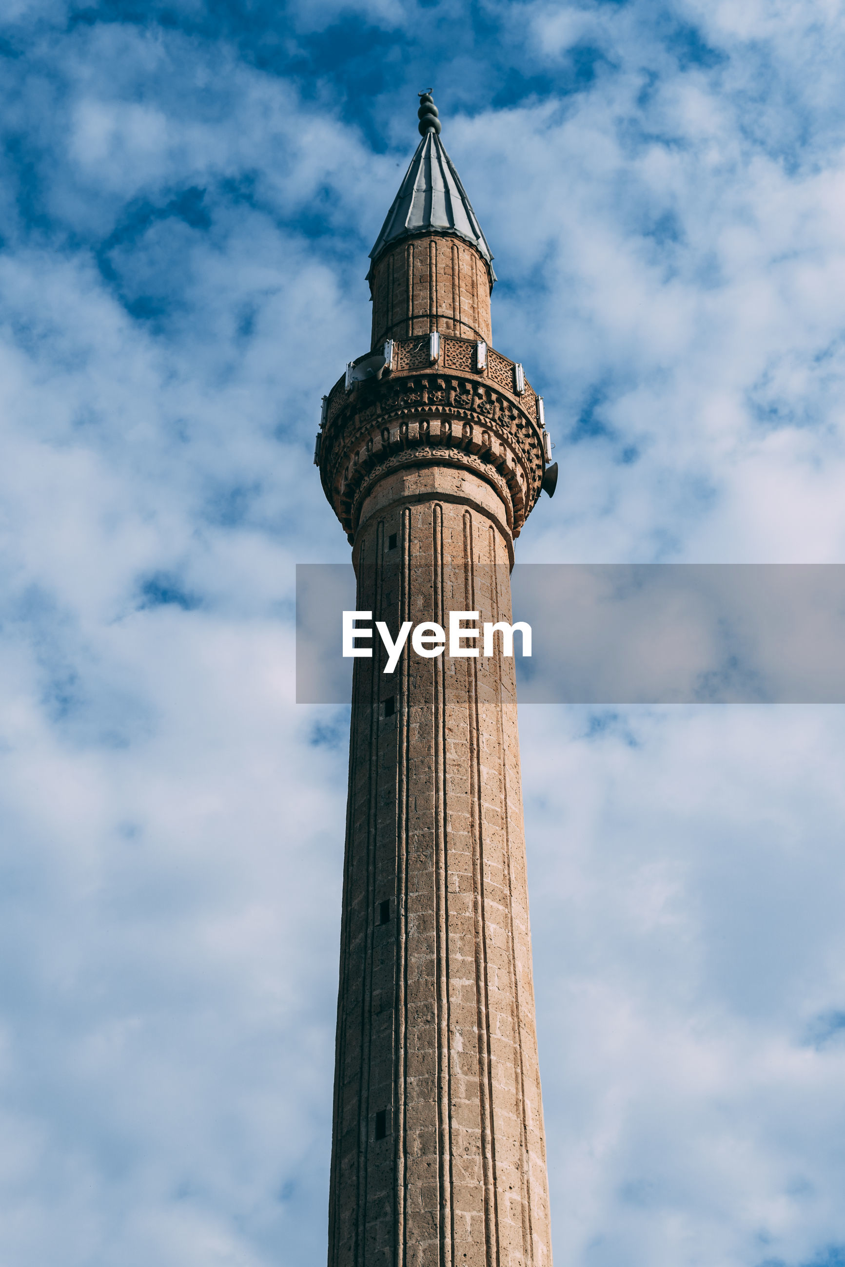 Low angle view of historical mosque minaret against sky