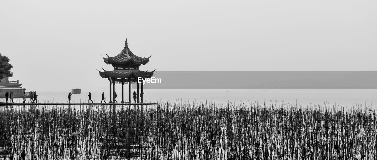 Pagoda Over Plants Against Clear Sky
