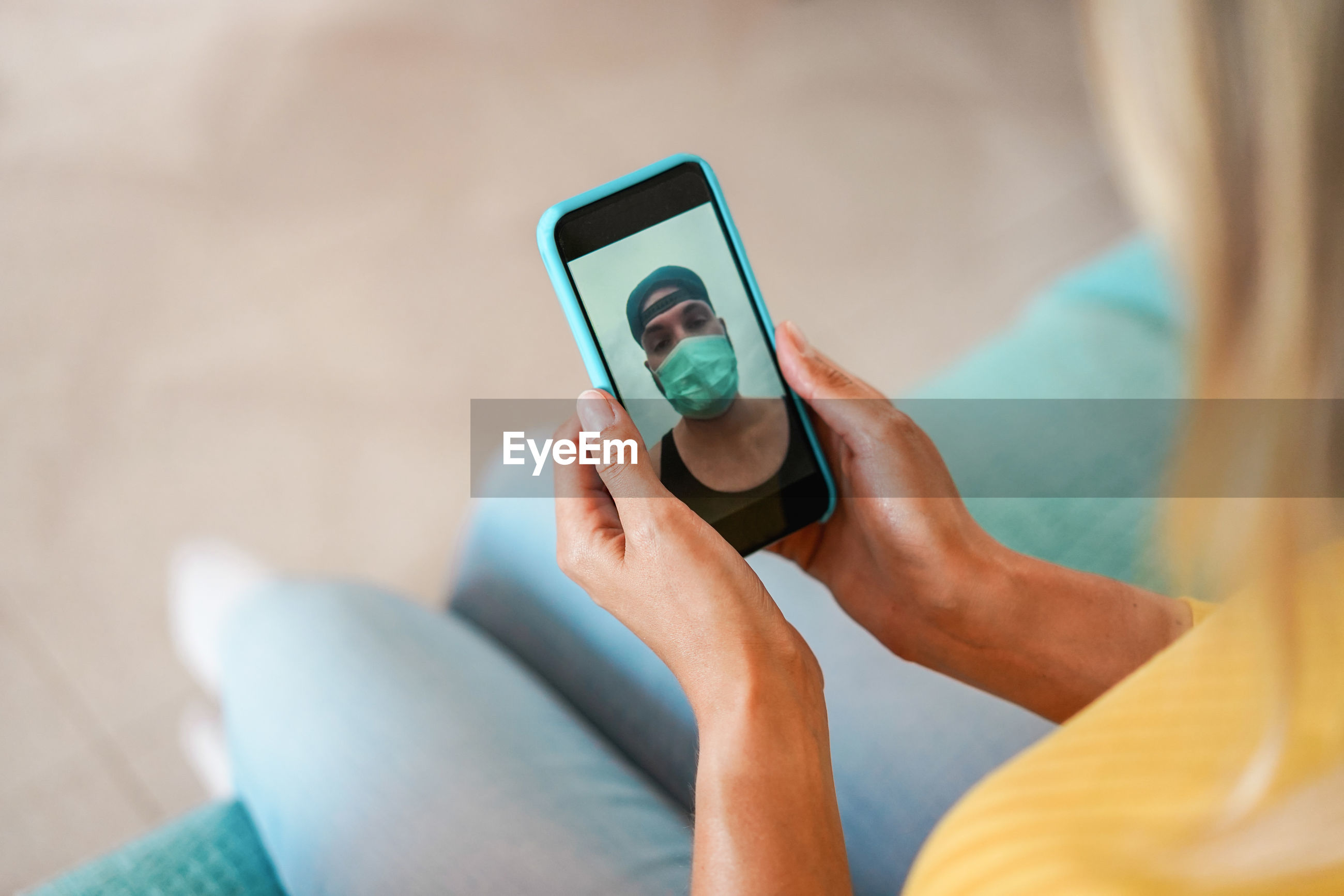 Midsection of woman video calling over smart phone