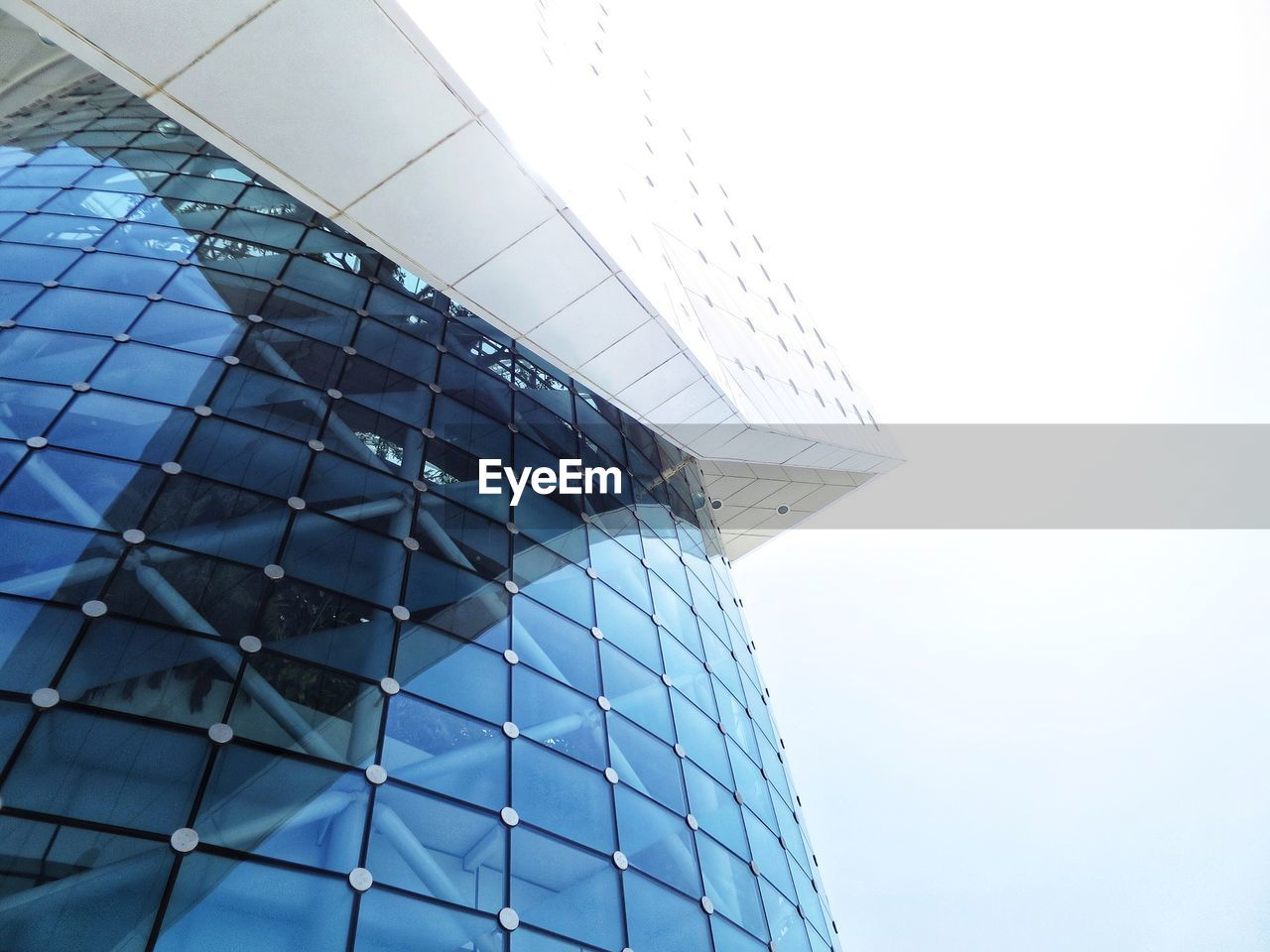 architecture, low angle view, modern, built structure, no people, day, building exterior, pattern, blue, clear sky, futuristic, outdoors, sky