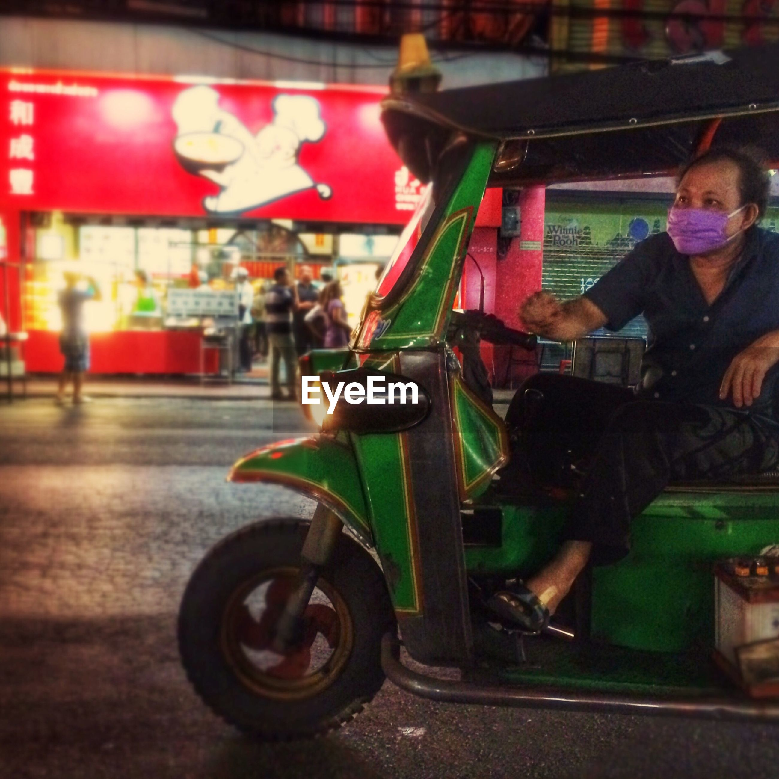 indoors, lifestyles, childhood, leisure activity, incidental people, land vehicle, men, street, focus on foreground, toy, transportation, mode of transport, selective focus, sitting, arts culture and entertainment, person, red, side view