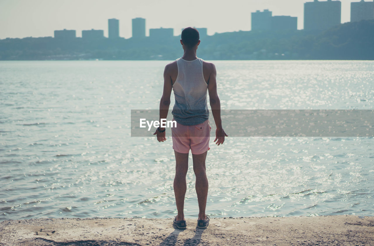 Rear View Full Length Of Man Standing At Beach