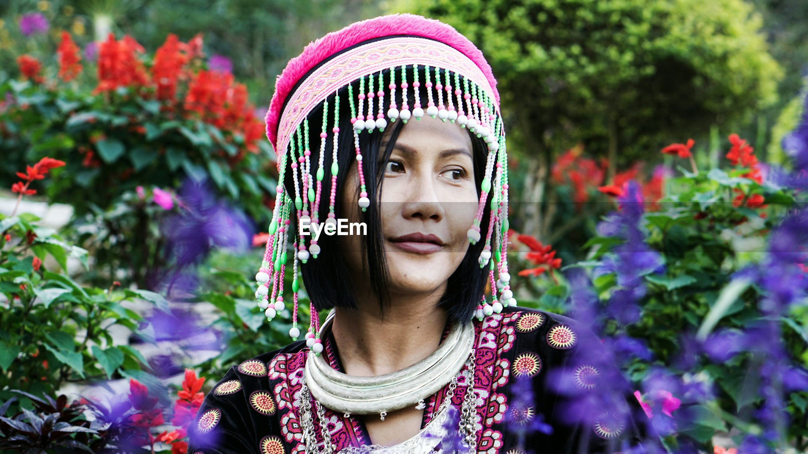 Woman in traditional clothing wearing headwear at park
