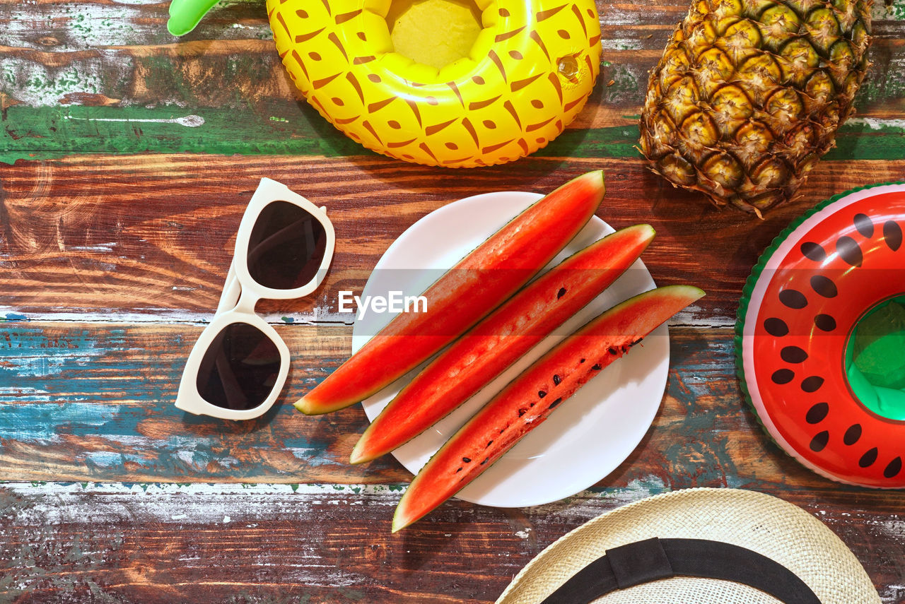 table, still life, food and drink, food, indoors, multi colored, no people, choice, group of objects, variation, healthy eating, high angle view, brush, close-up, wood - material, paintbrush, directly above, fruit, kitchen utensil, container