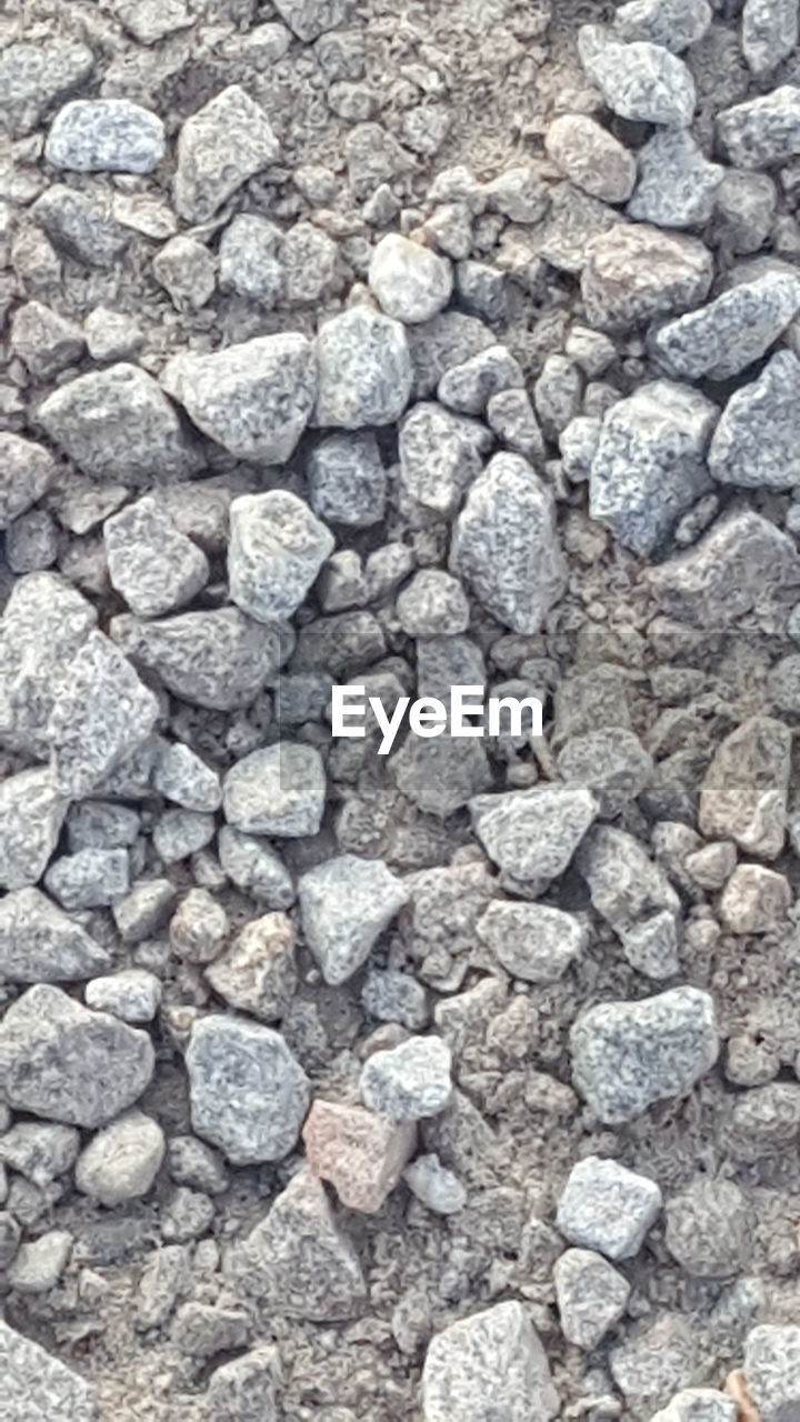 solid, rock, full frame, rock - object, stone - object, gray, stone, no people, backgrounds, large group of objects, pebble, textured, nature, abundance, studio shot, gravel, mineral, high angle view, directly above, close-up, silver colored, precious gem