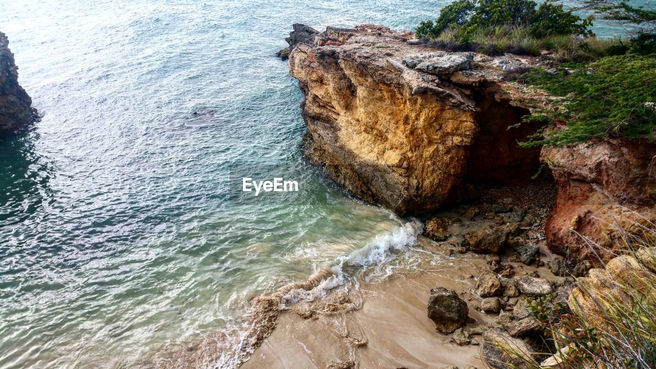 rock - object, nature, rock formation, water, scenics, sea, beauty in nature, high angle view, no people, tranquility, wave, day, outdoors, motion, travel destinations, beach