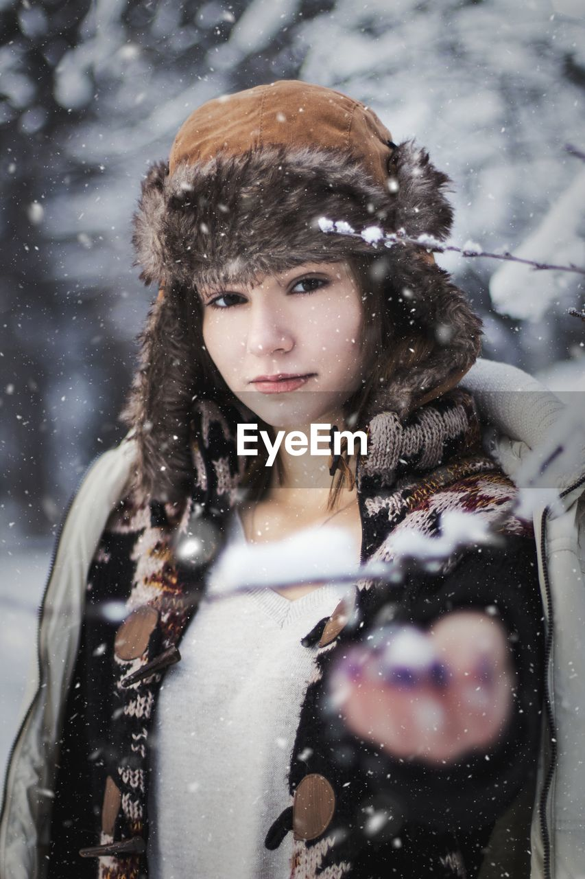 Portrait of woman outdoors during snowfall