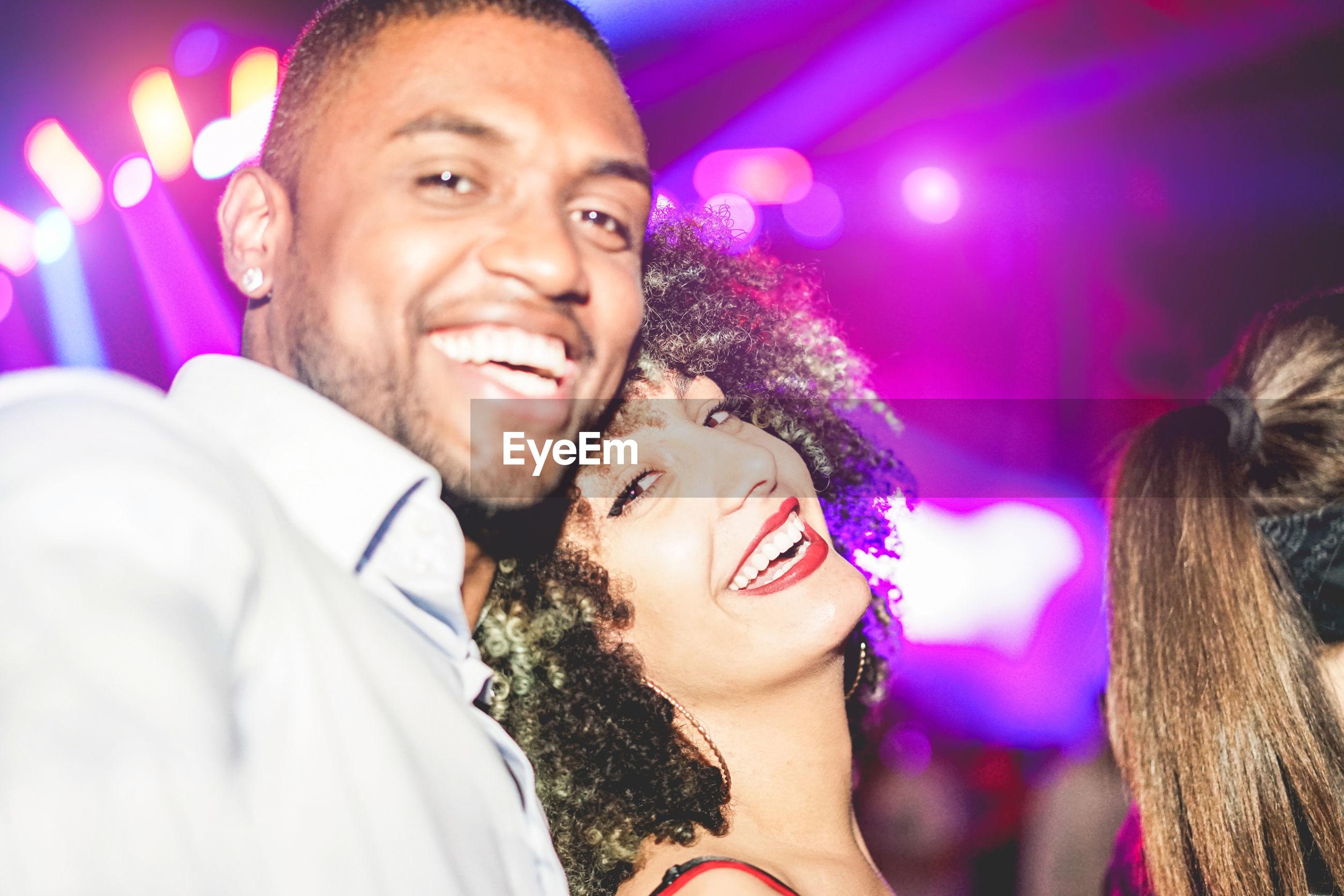Friends enjoying in nightclub