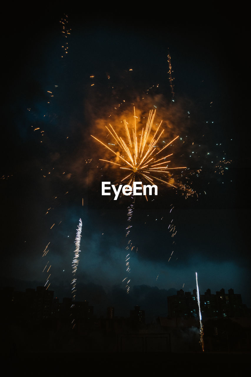 night, firework, firework display, motion, exploding, illuminated, arts culture and entertainment, long exposure, celebration, event, sky, firework - man made object, blurred motion, glowing, low angle view, architecture, nature, building exterior, no people, outdoors, light, sparks, dark, explosive