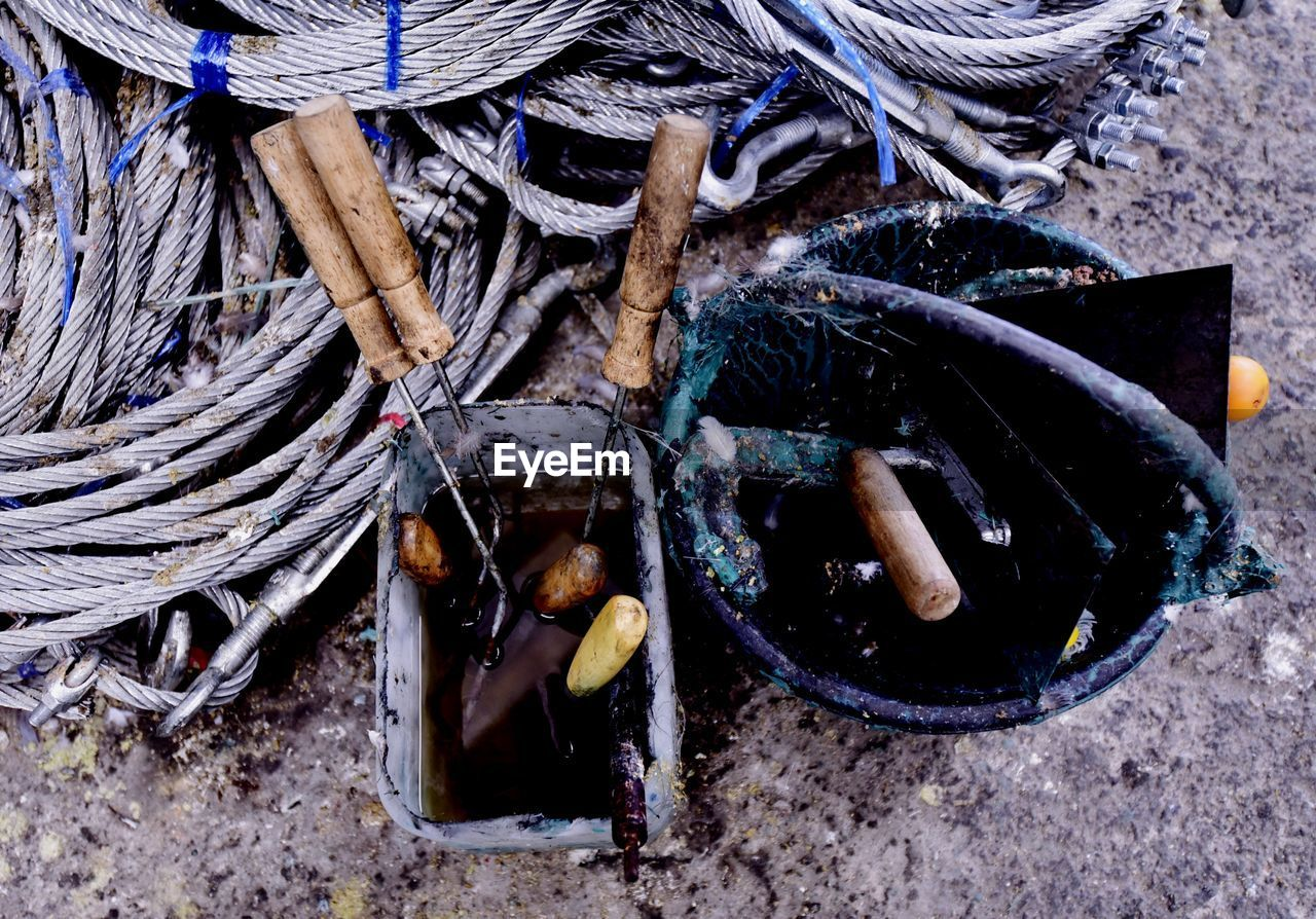 high angle view, day, no people, rope, wood - material, close-up, outdoors, still life, land, strength, connection, tied up, nature, fishing, wood, complexity, field, group of objects, fishing net, fishing industry, tangled