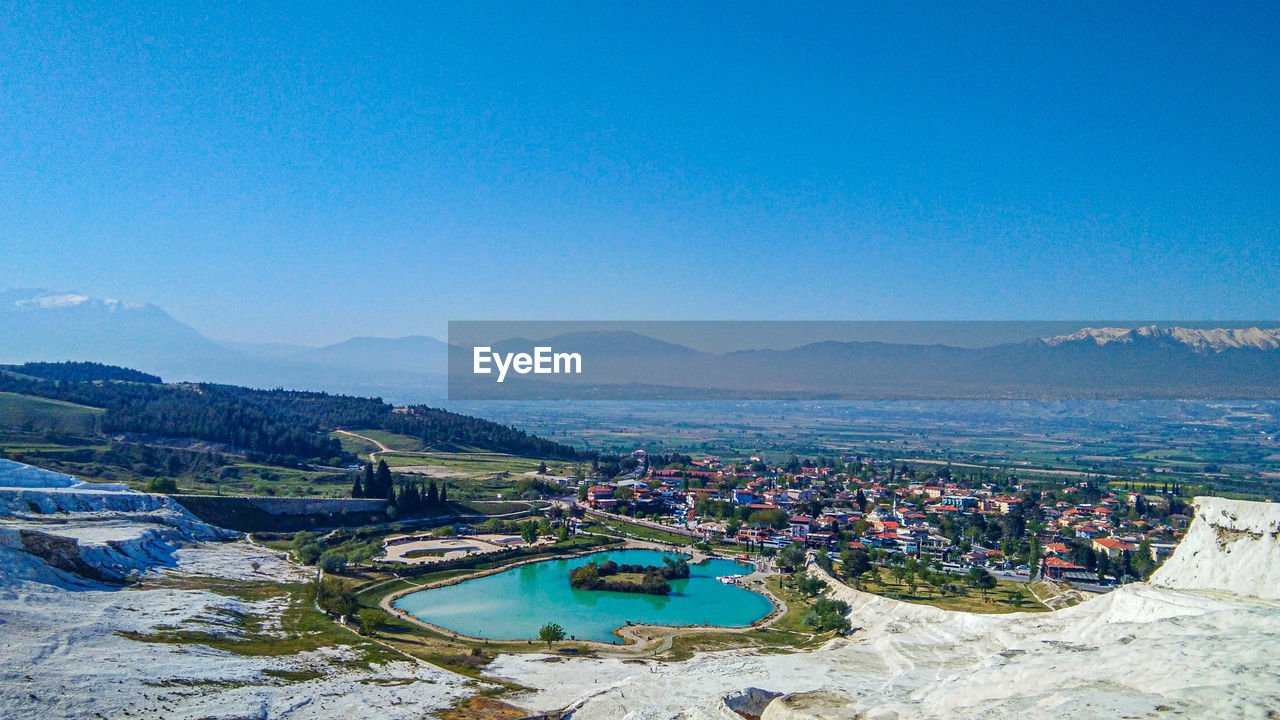HIGH ANGLE VIEW OF SWIMMING POOL AGAINST CLEAR SKY