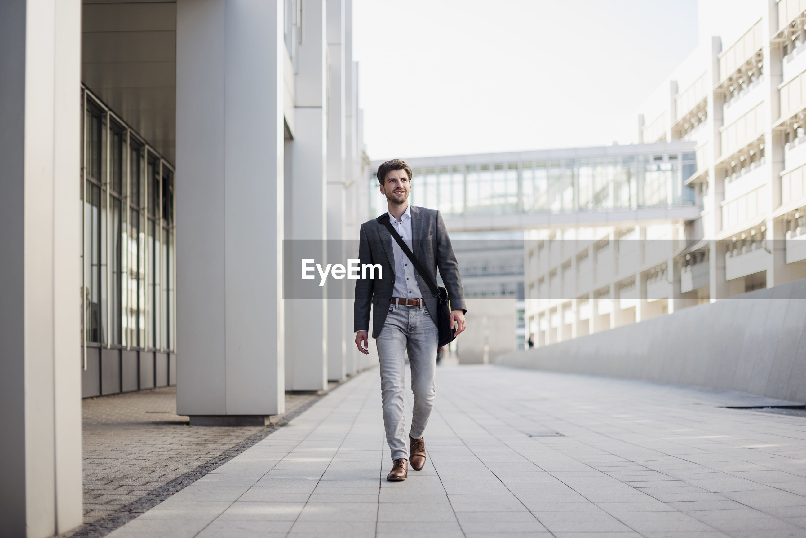 FULL LENGTH OF A MAN WALKING IN BUILDING