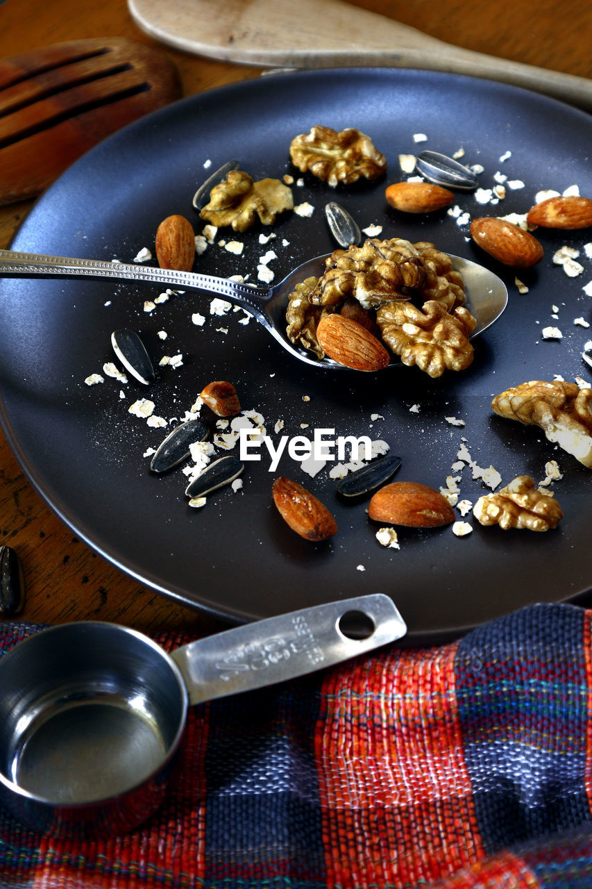 food, food and drink, kitchen utensil, indoors, freshness, still life, spoon, eating utensil, no people, table, high angle view, close-up, wellbeing, healthy eating, ready-to-eat, directly above, plate, household equipment, indulgence, vegetable, tray, snack