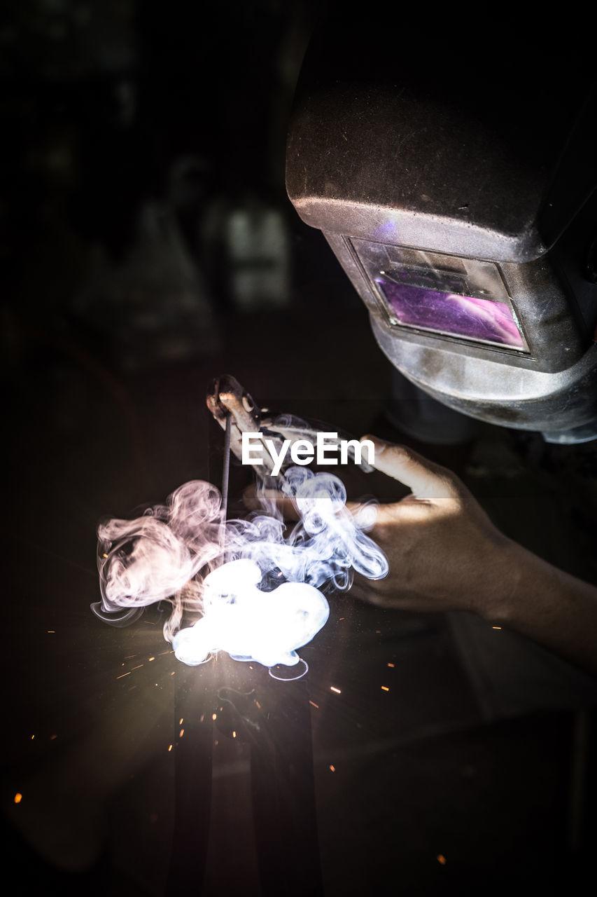 Close-up of man welding
