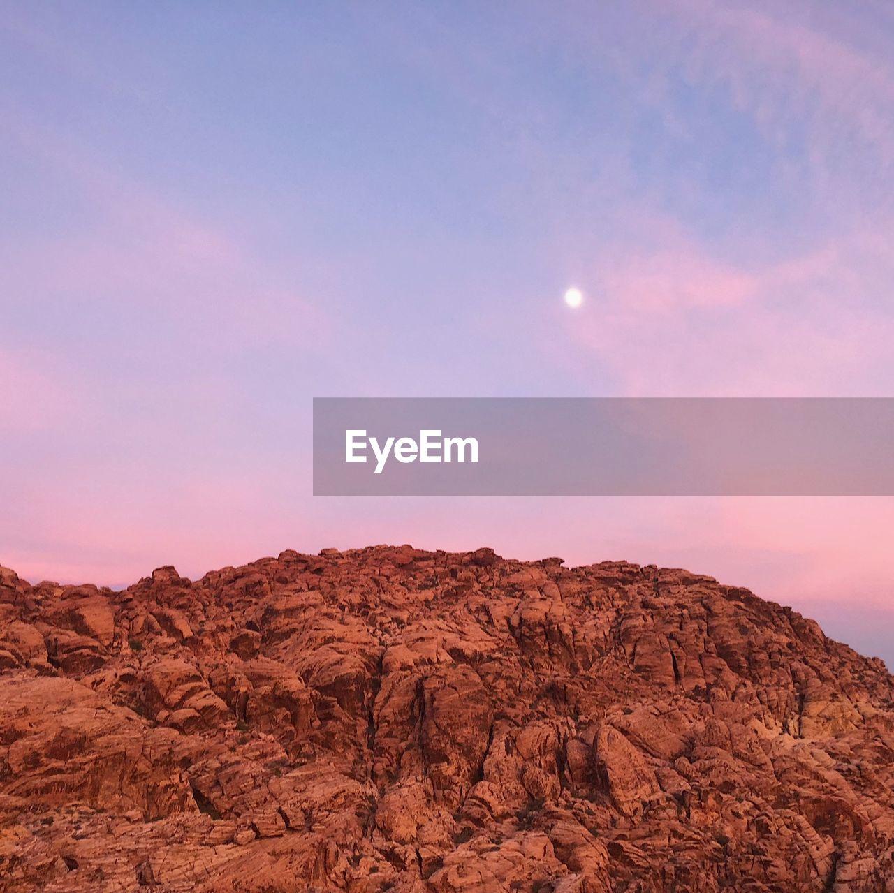 Rock Formation On Landscape Against Sky During Sunset