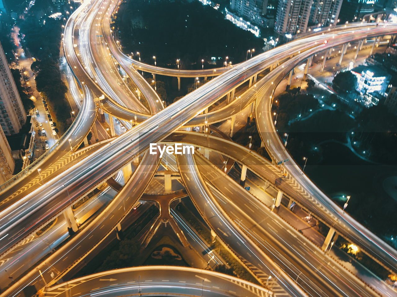 Aerial View Of Light Trails On Elevated Roads At Night