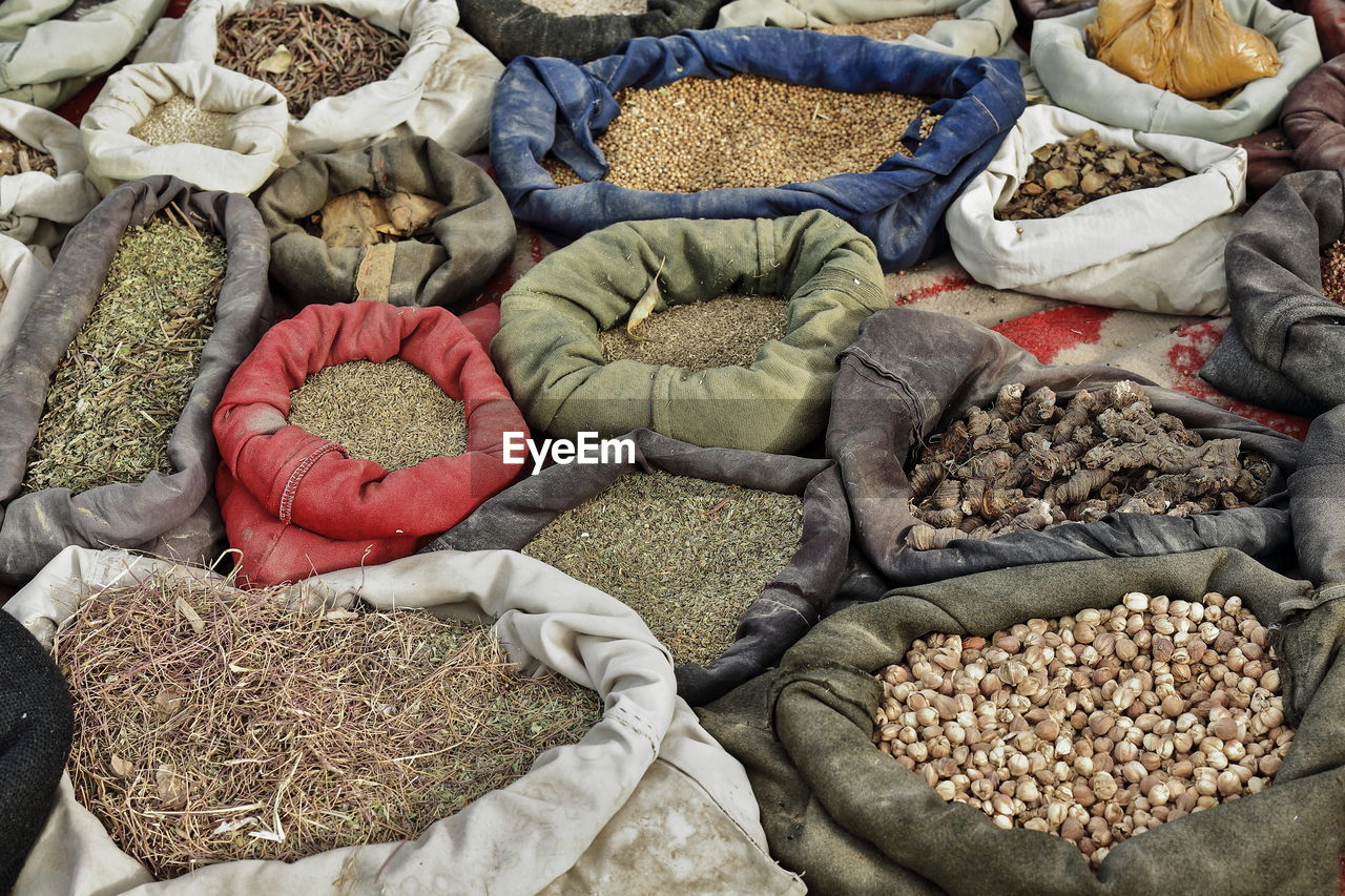 retail, large group of objects, market, choice, variation, for sale, sack, high angle view, abundance, market stall, day, no people, business, food and drink, freshness, arrangement, food, bag, still life, plastic, retail display, plastic bag