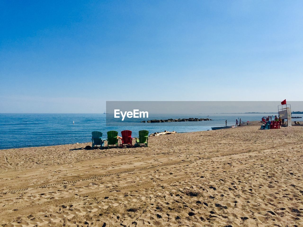 sea, beach, water, land, sky, sand, horizon over water, scenics - nature, horizon, beauty in nature, copy space, clear sky, day, nature, blue, tranquility, incidental people, tranquil scene, outdoors