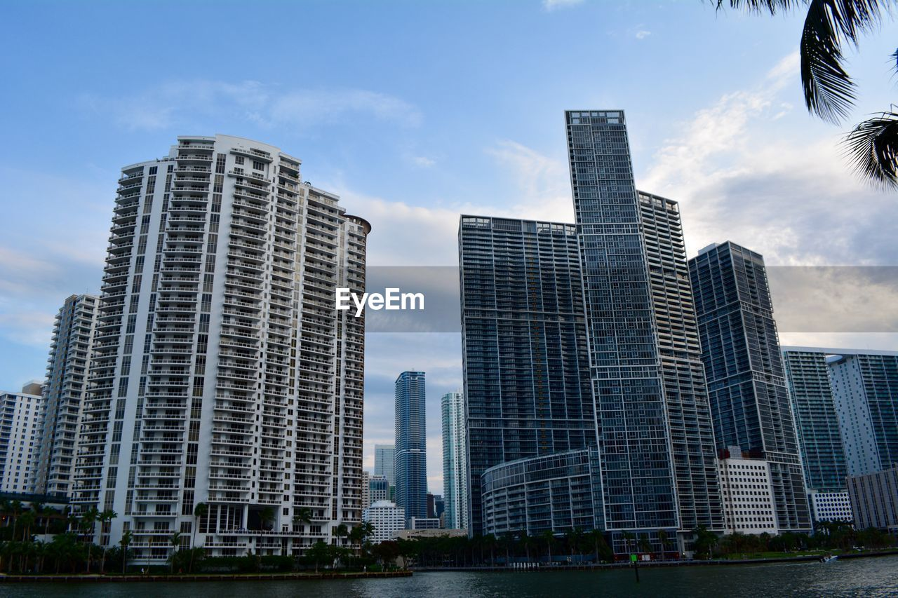 building exterior, built structure, architecture, city, building, sky, modern, office building exterior, tall - high, skyscraper, cloud - sky, urban skyline, office, tower, no people, nature, day, landscape, low angle view, outdoors, cityscape, financial district