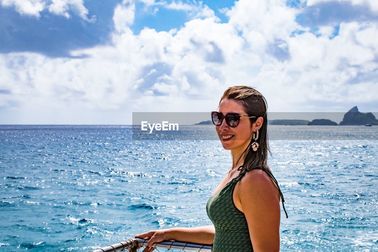 glasses, sunglasses, sea, fashion, sky, water, one person, cloud - sky, real people, lifestyles, young adult, leisure activity, young women, beauty in nature, scenics - nature, portrait, nature, day, horizon over water, hairstyle, hair, beautiful woman, outdoors