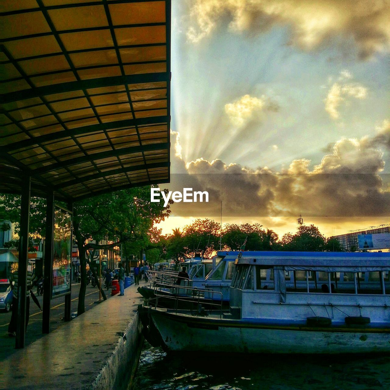 sky, transportation, cloud - sky, mode of transport, built structure, sunset, outdoors, day, architecture, nautical vessel, building exterior, nature, no people, tree, city