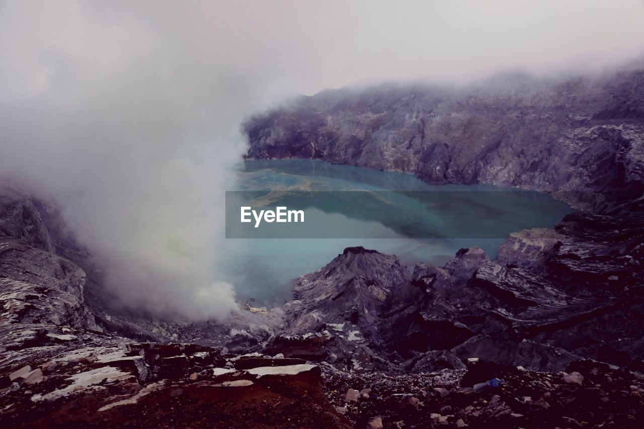 geology, water, volcano, beauty in nature, smoke - physical structure, scenics - nature, mountain, erupting, physical geography, non-urban scene, nature, no people, power in nature, environment, tranquil scene, landscape, steam, heat - temperature, tranquility, emitting, volcanic crater, outdoors, hot spring