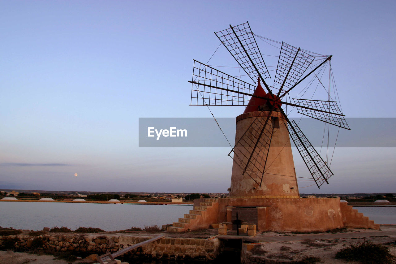 Traditional windmill against sky