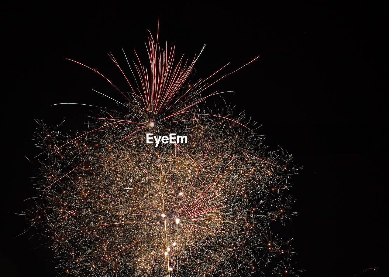 night, illuminated, celebration, firework, firework display, motion, exploding, event, glowing, long exposure, arts culture and entertainment, sky, no people, low angle view, nature, light, firework - man made object, multi colored, outdoors, sparks