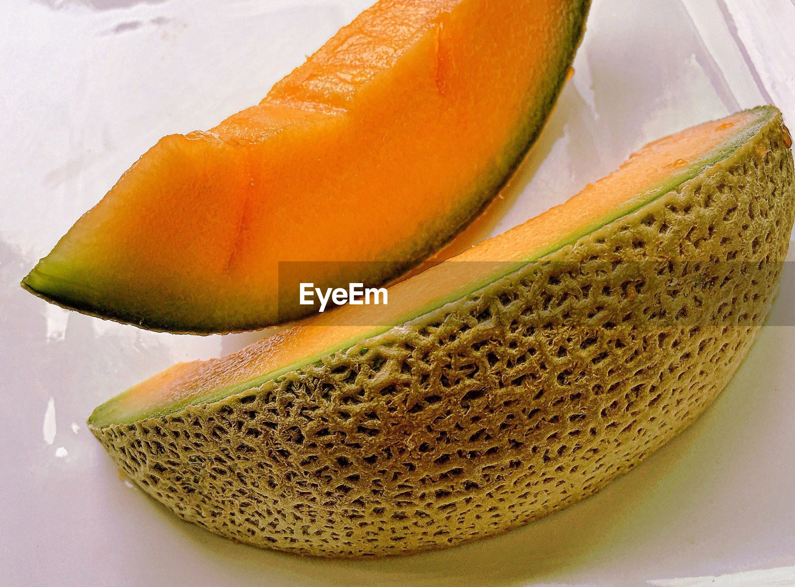 Close-up of sliced muskmelon on table