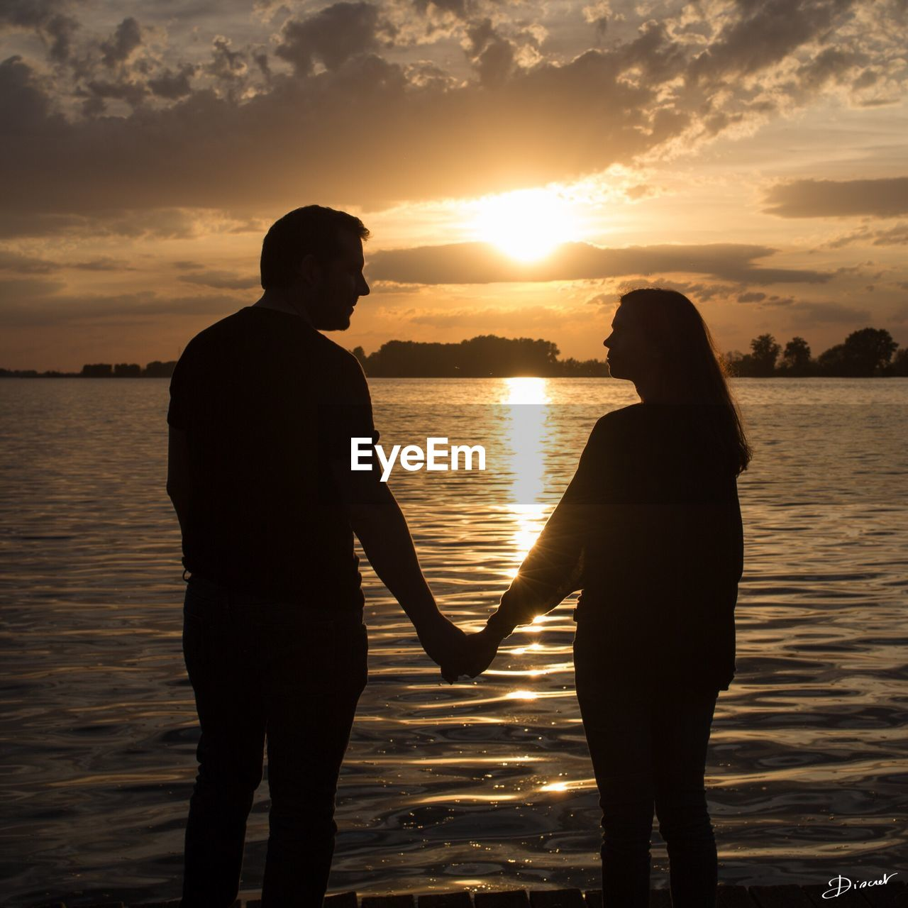 sunset, water, love, two people, togetherness, silhouette, sea, romance, nature, standing, real people, beauty in nature, sky, bonding, leisure activity, scenics, men, lifestyles, sun, women, outdoors, full length, horizon over water, friendship, adult, people