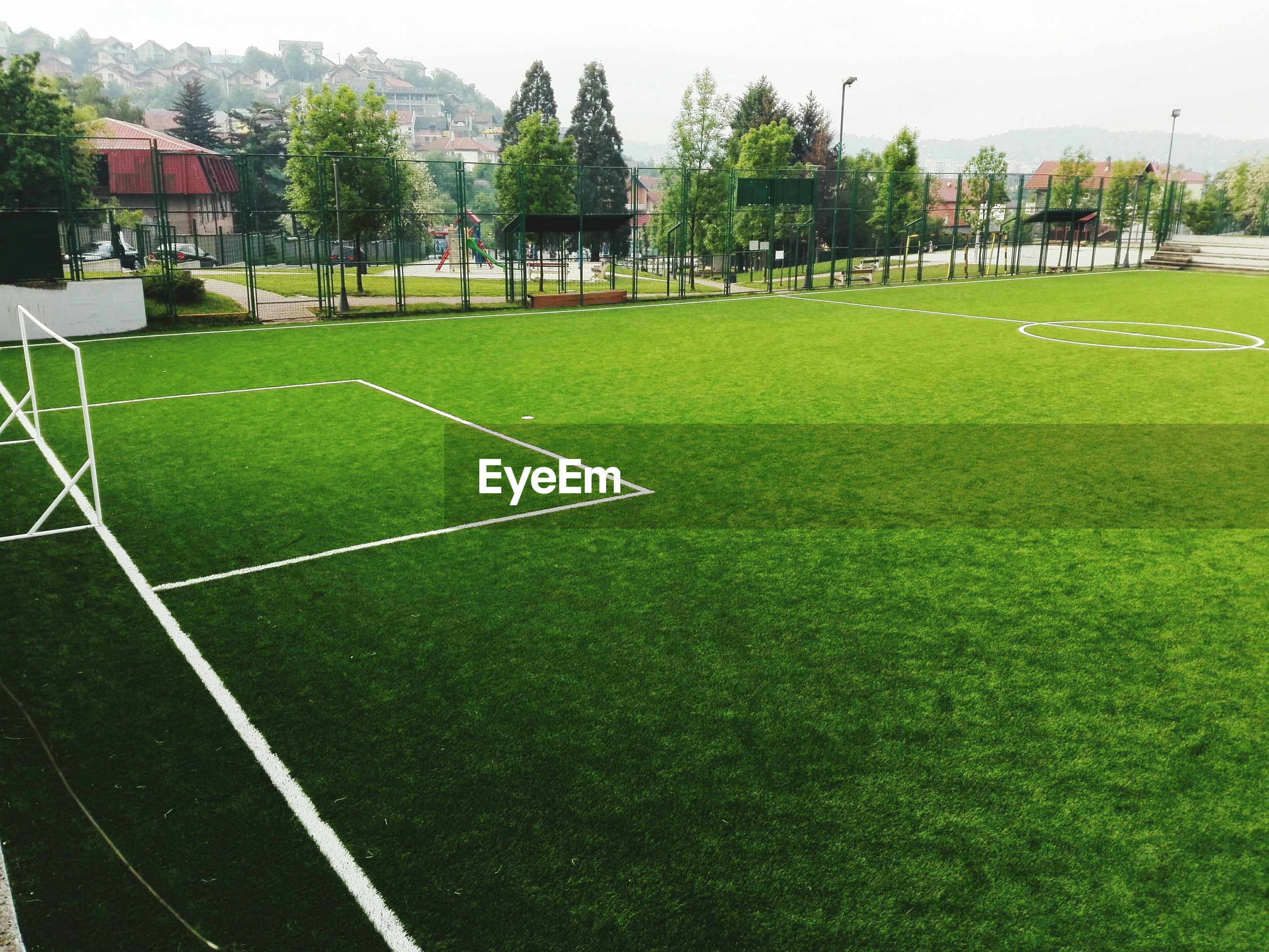 Empty soccer field against sky
