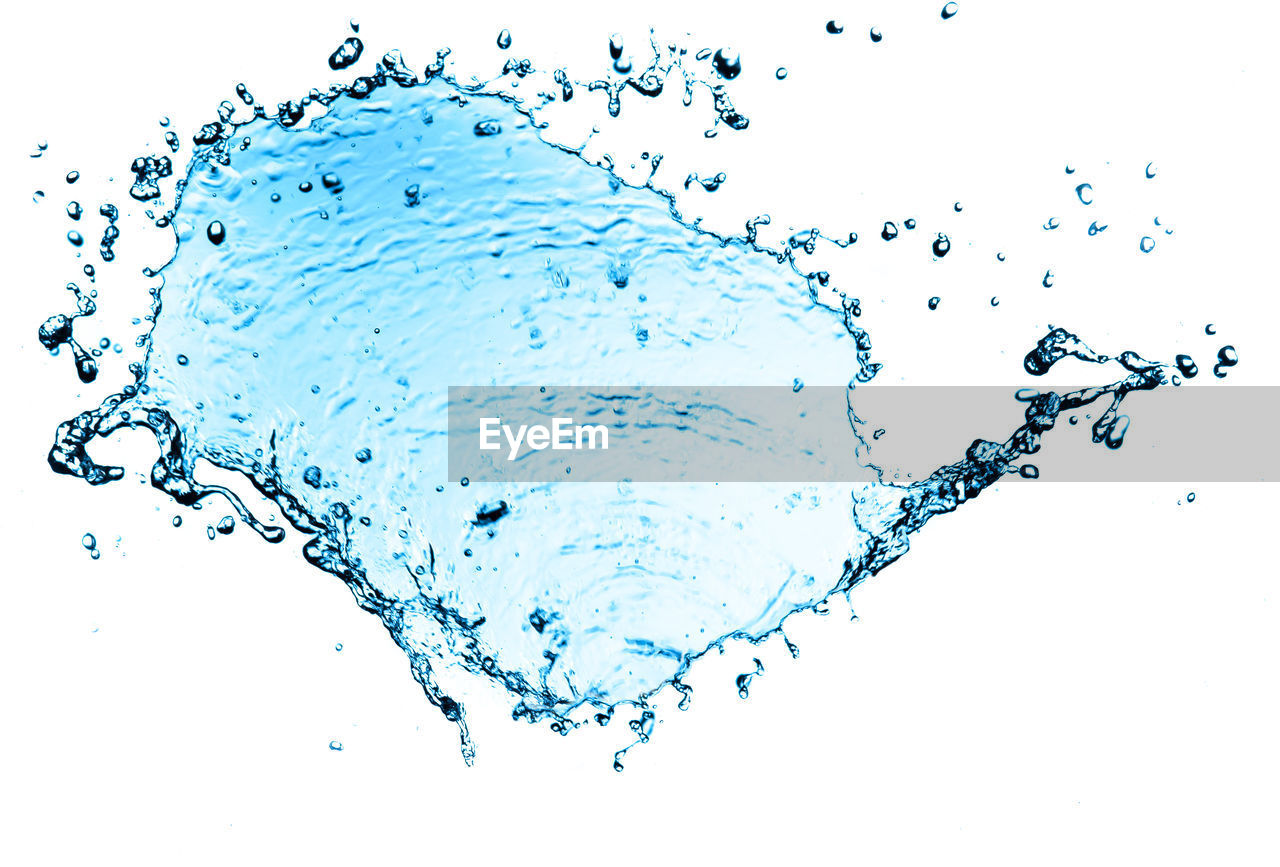 water, drop, splashing, studio shot, motion, white background, nature, no people, blue, purity, close-up, abstract, food and drink, freshness, sea, indoors, transparent, wet, flowing water, clean, turquoise colored, blue background