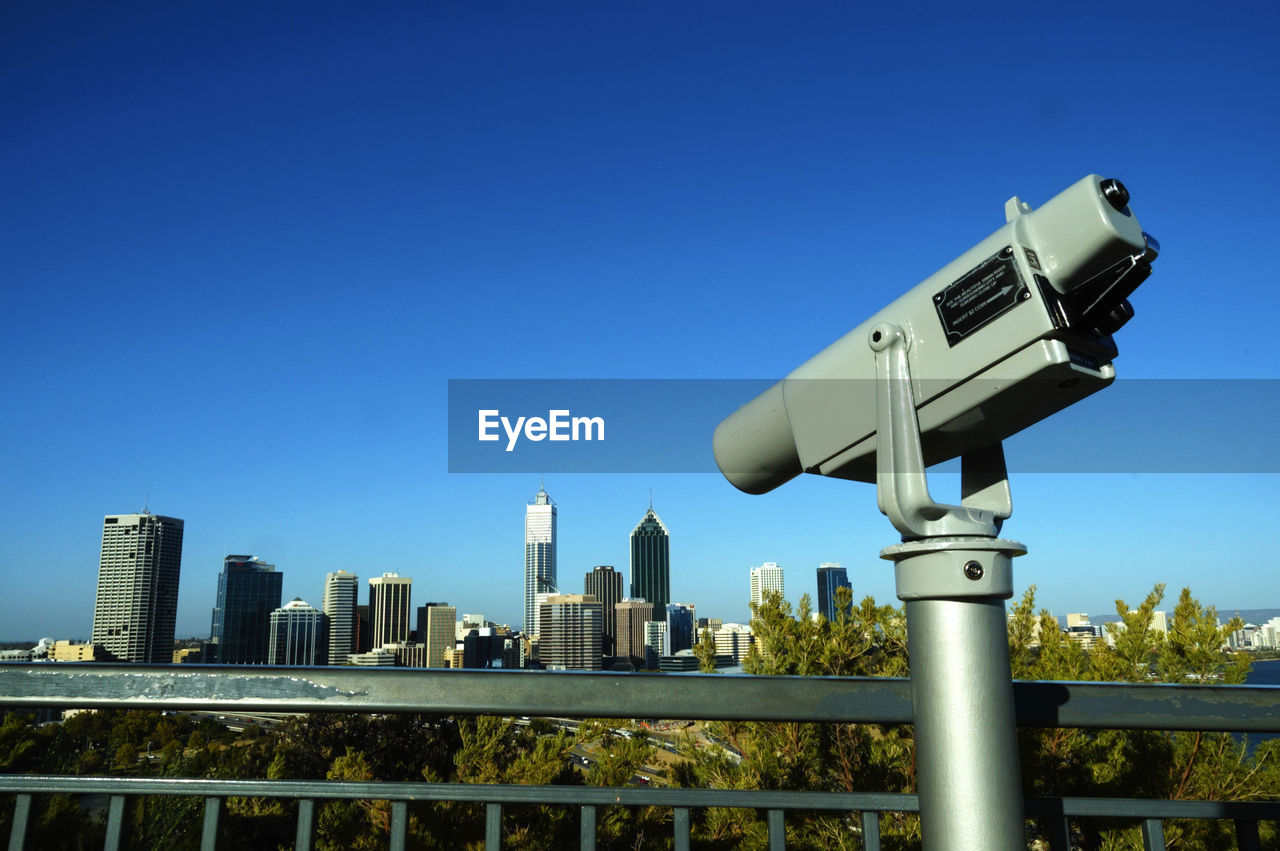 Coin Operated Binoculars At Kings Park Against Clear Blue Sky Over City