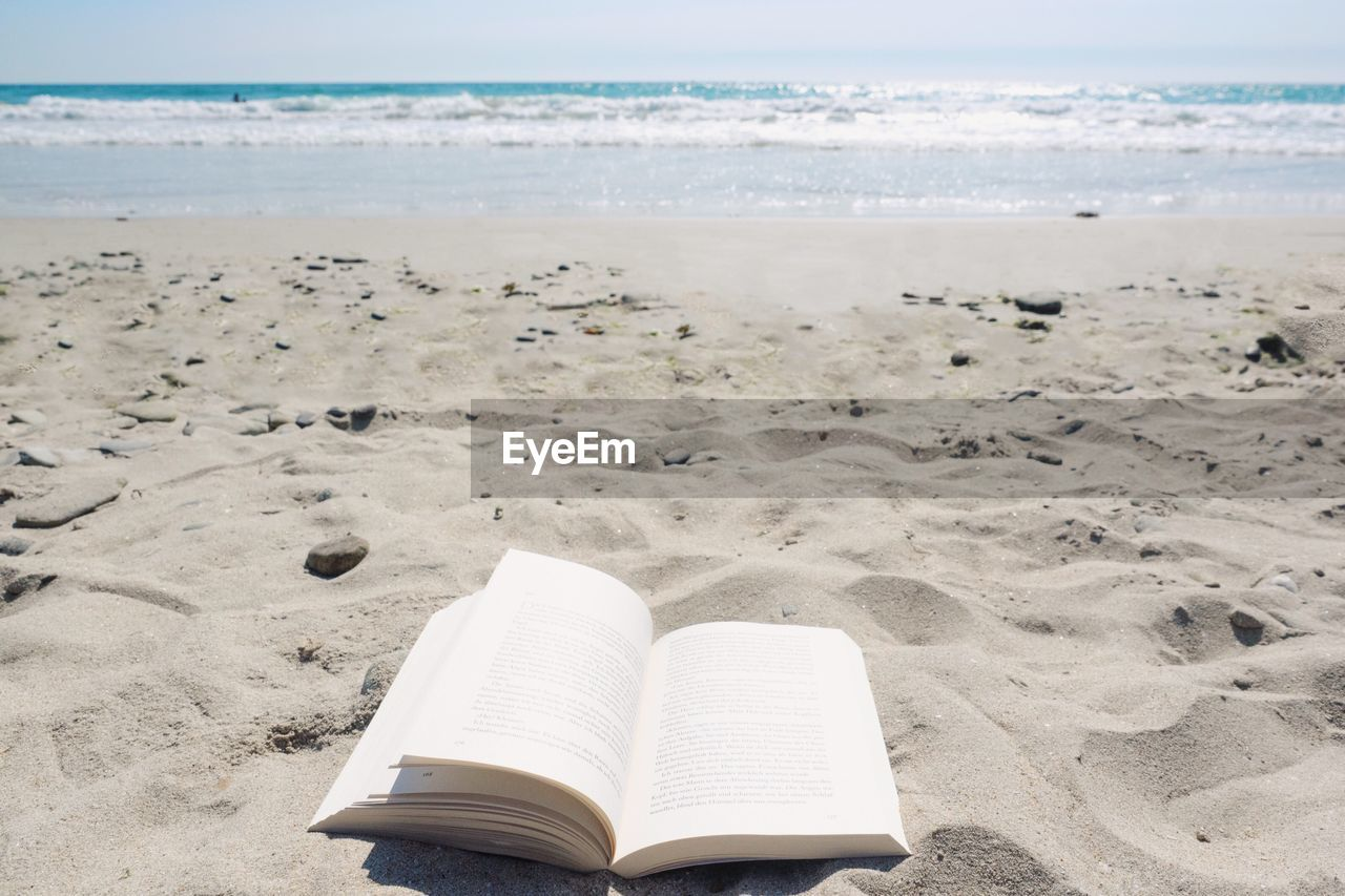 beach, land, publication, sand, book, water, sea, nature, horizon over water, beauty in nature, horizon, sky, tranquility, tranquil scene, day, scenics - nature, no people, open, education, outdoors