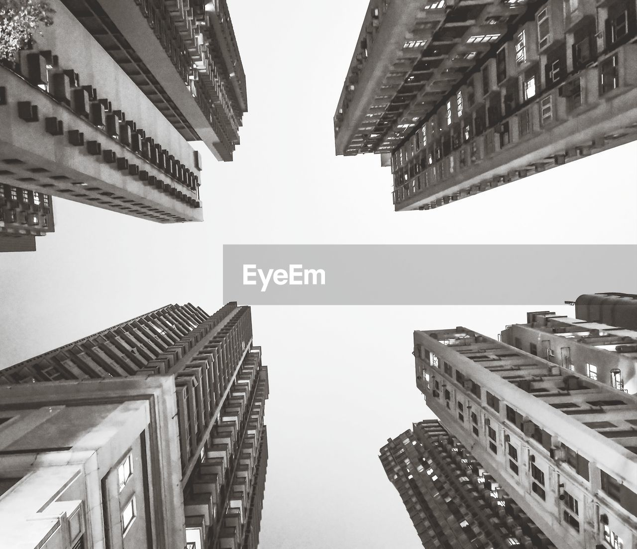 building exterior, architecture, built structure, city, sky, low angle view, office building exterior, tall - high, building, skyscraper, no people, nature, office, clear sky, modern, residential district, outdoors, tower, day, city life, financial district, directly below, apartment