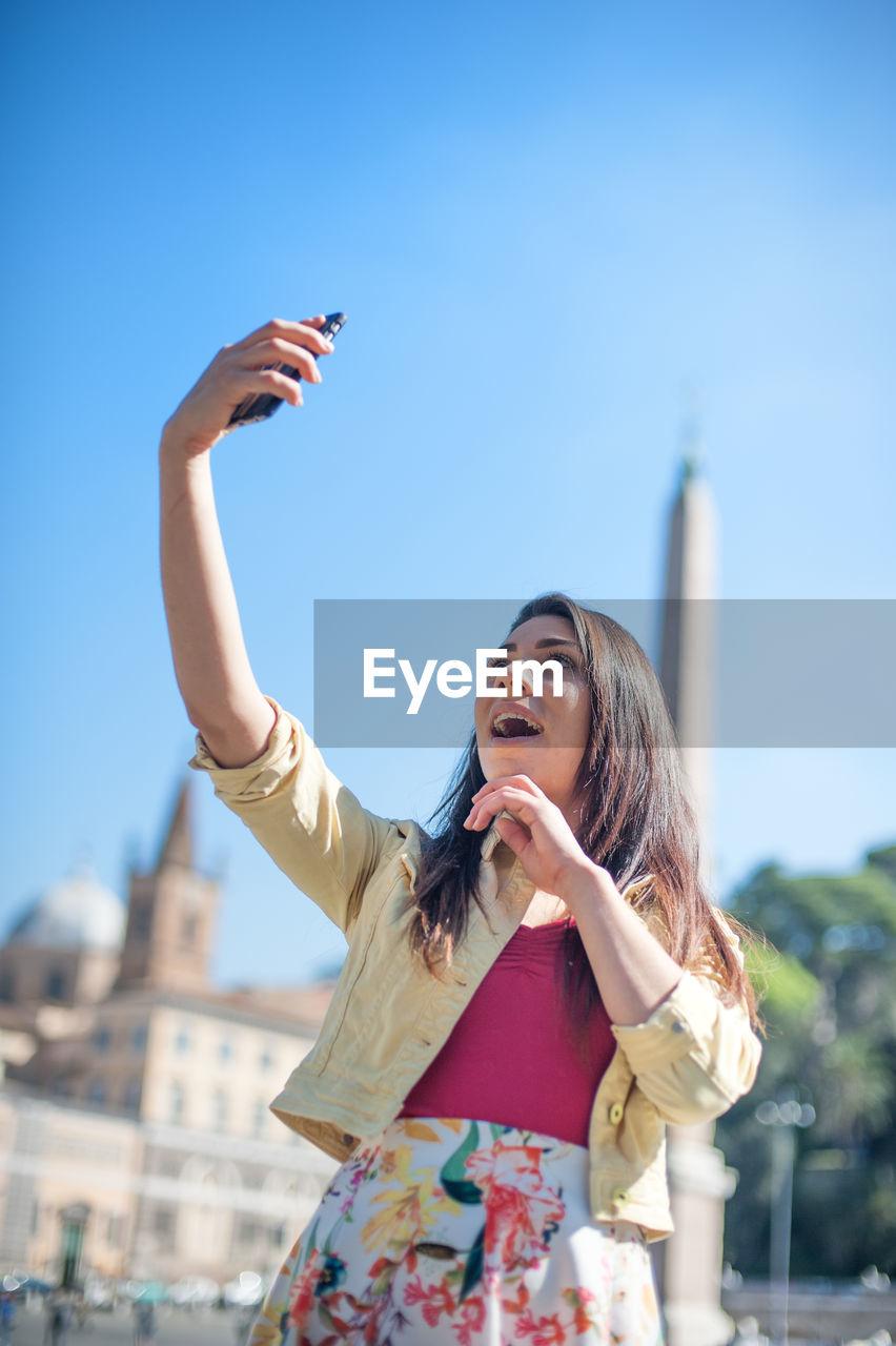 Women Taking Selfie Against Clear Blue Sky