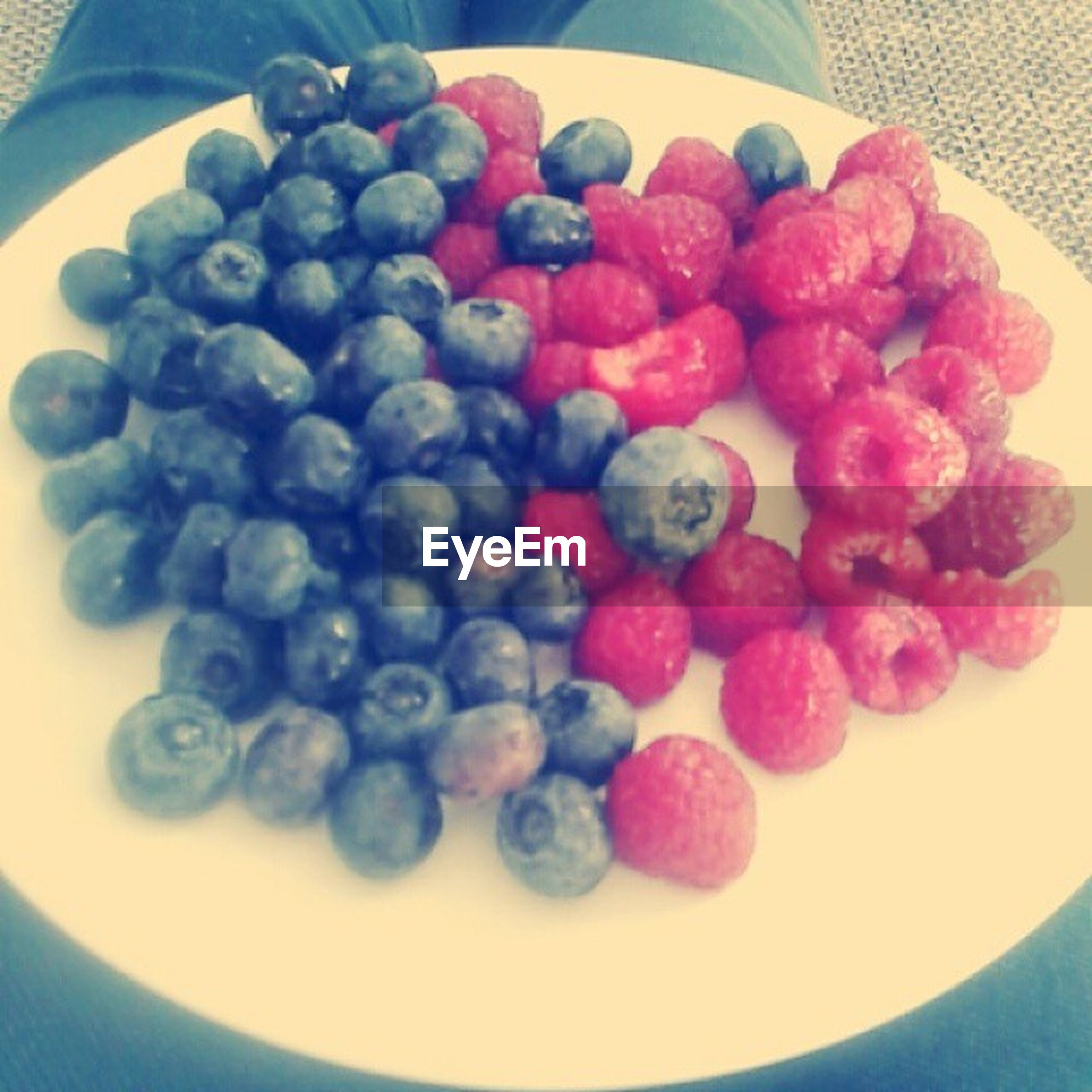 food and drink, food, fruit, freshness, indoors, healthy eating, blueberry, still life, high angle view, large group of objects, raspberry, berry fruit, grape, abundance, close-up, sweet food, strawberry, bowl, blackberry - fruit, table