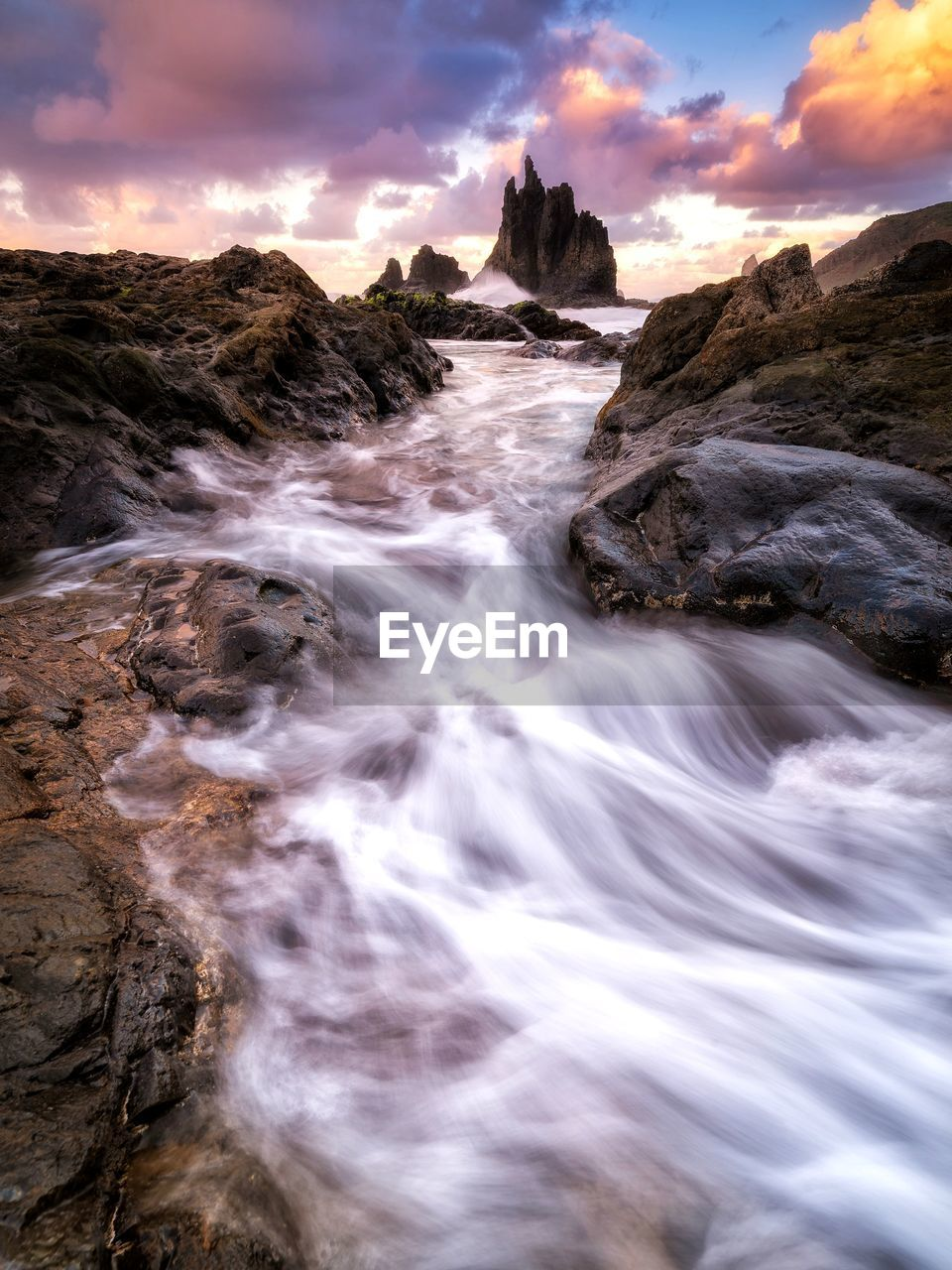 scenics - nature, beauty in nature, rock, motion, water, sky, long exposure, solid, rock - object, cloud - sky, rock formation, sunset, nature, flowing water, blurred motion, no people, sea, land, waterfall, outdoors, flowing, power in nature