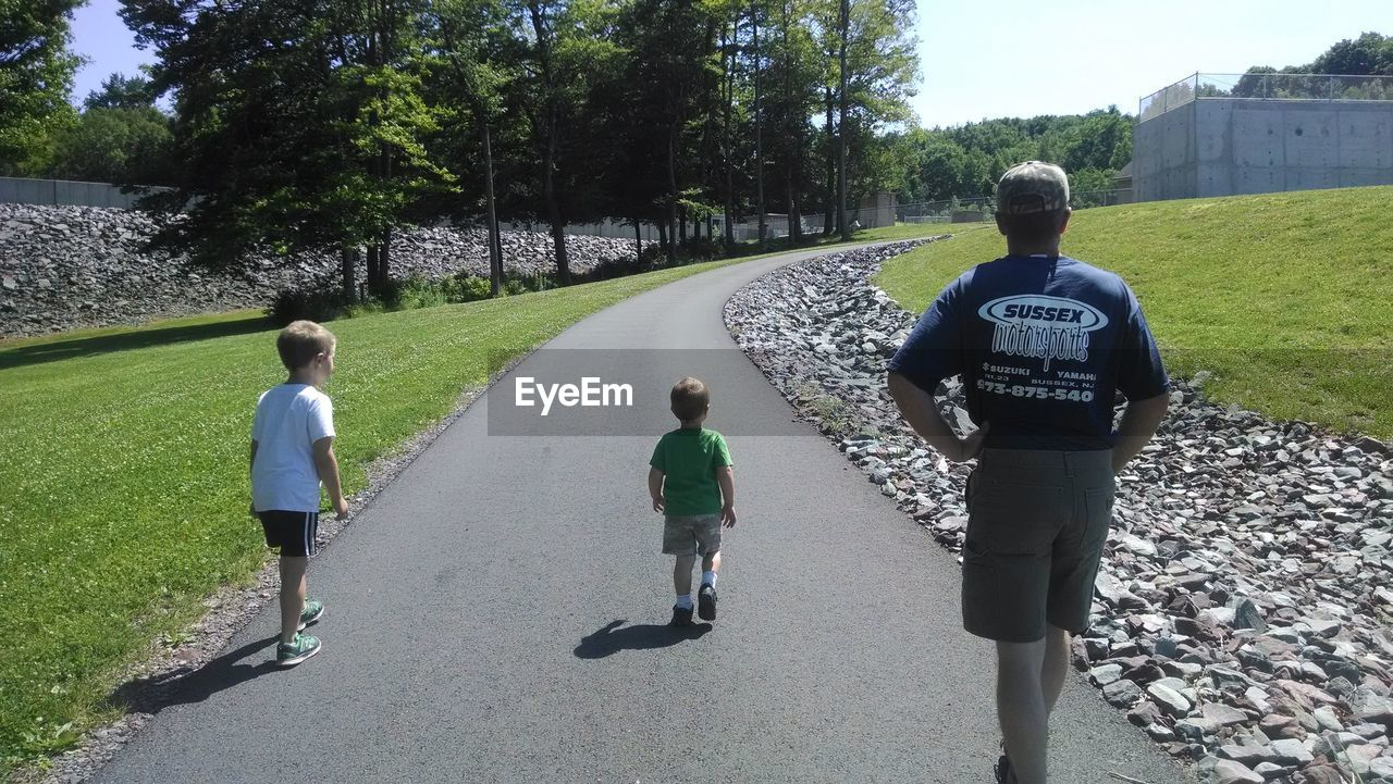 tree, rear view, childhood, grass, day, growth, outdoors, road, full length, boys, nature, people