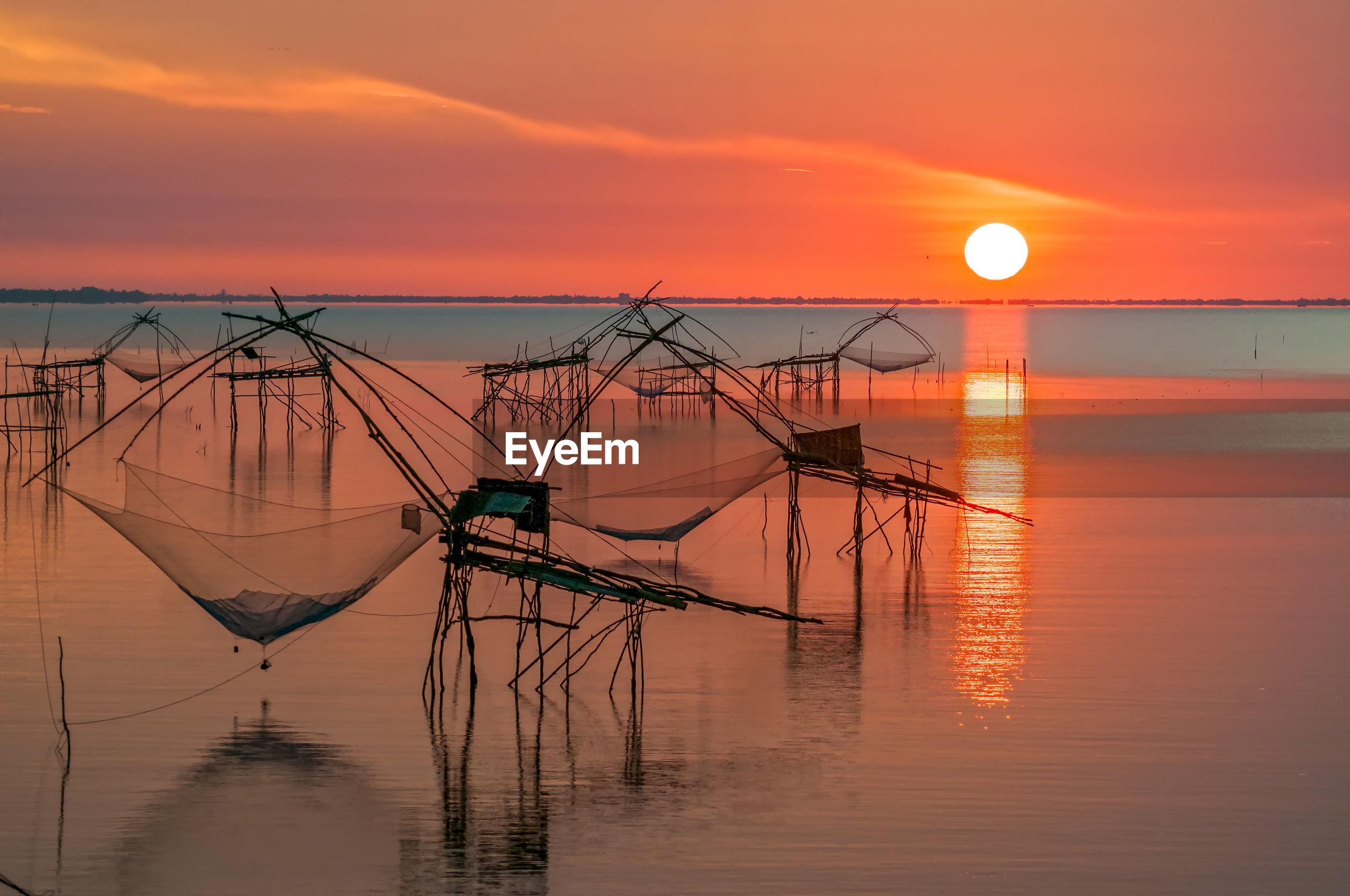 Fishing net gears in the lake and beautiful sunrise at pakpra.