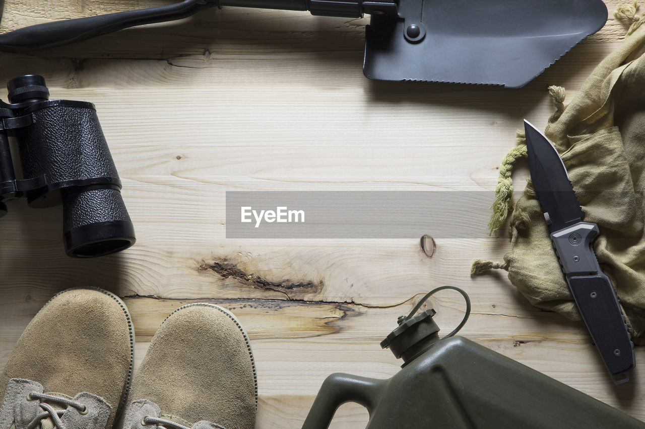 High angle view of camping tools on table