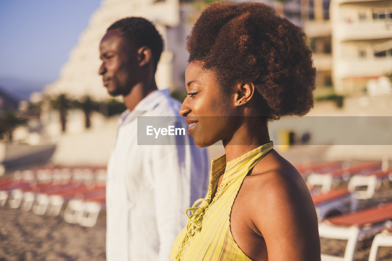 Couple Standing At Beach During Sunset