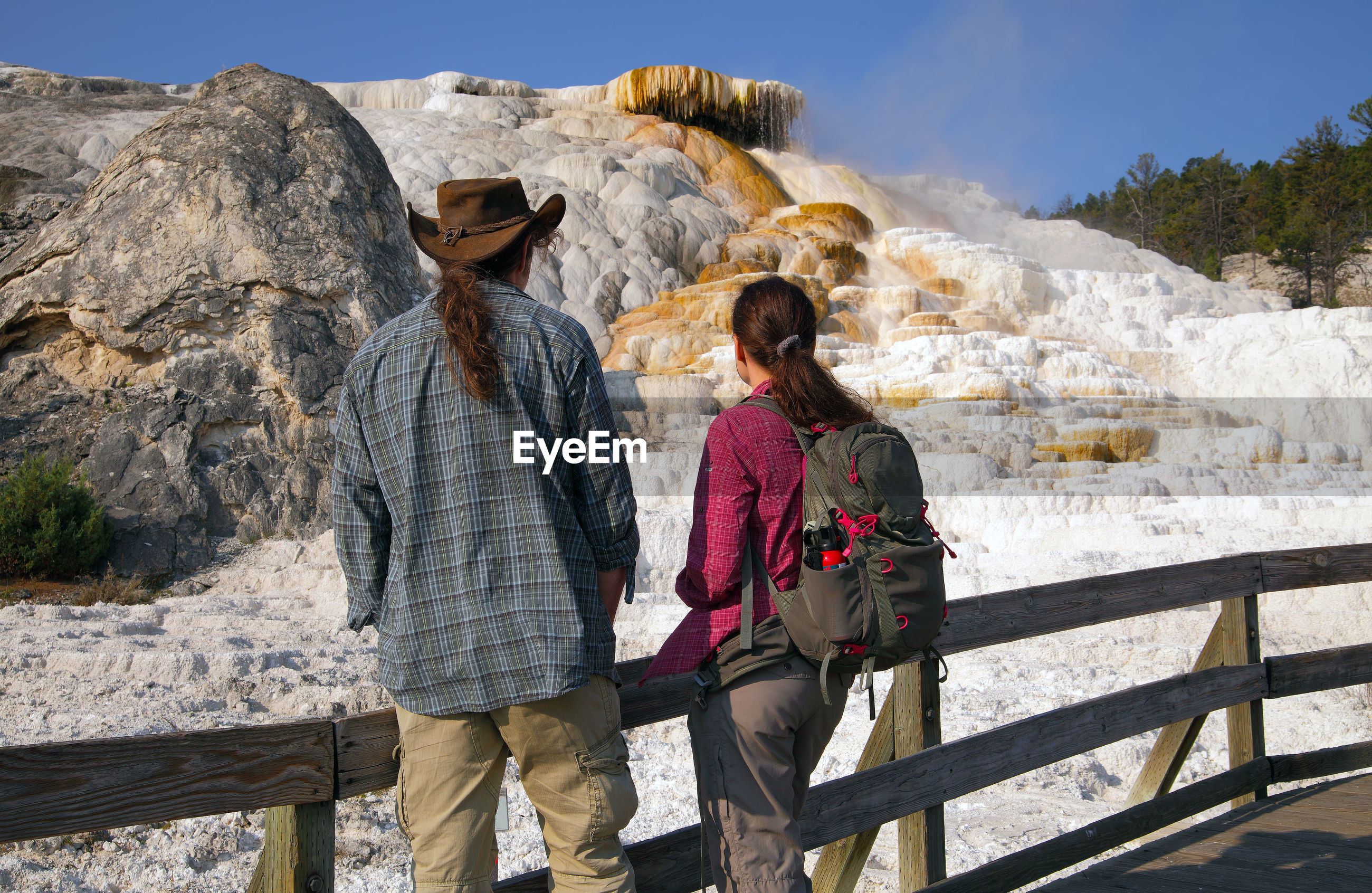 Rear view of couple looking at volcanic landscape