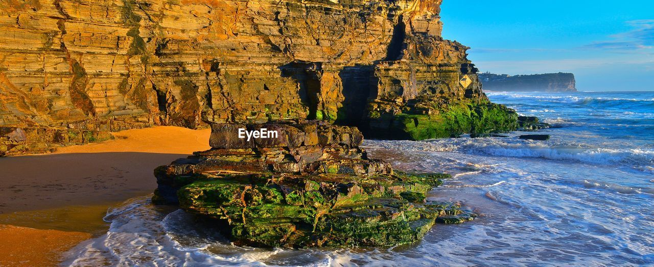rock formation, rock - object, nature, beauty in nature, scenics, geology, sea, water, physical geography, tranquil scene, cliff, tranquility, natural arch, no people, day, sky, outdoors, travel destinations