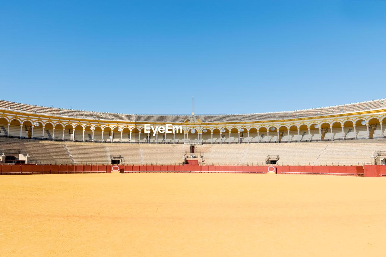 Stadium against clear blue sky