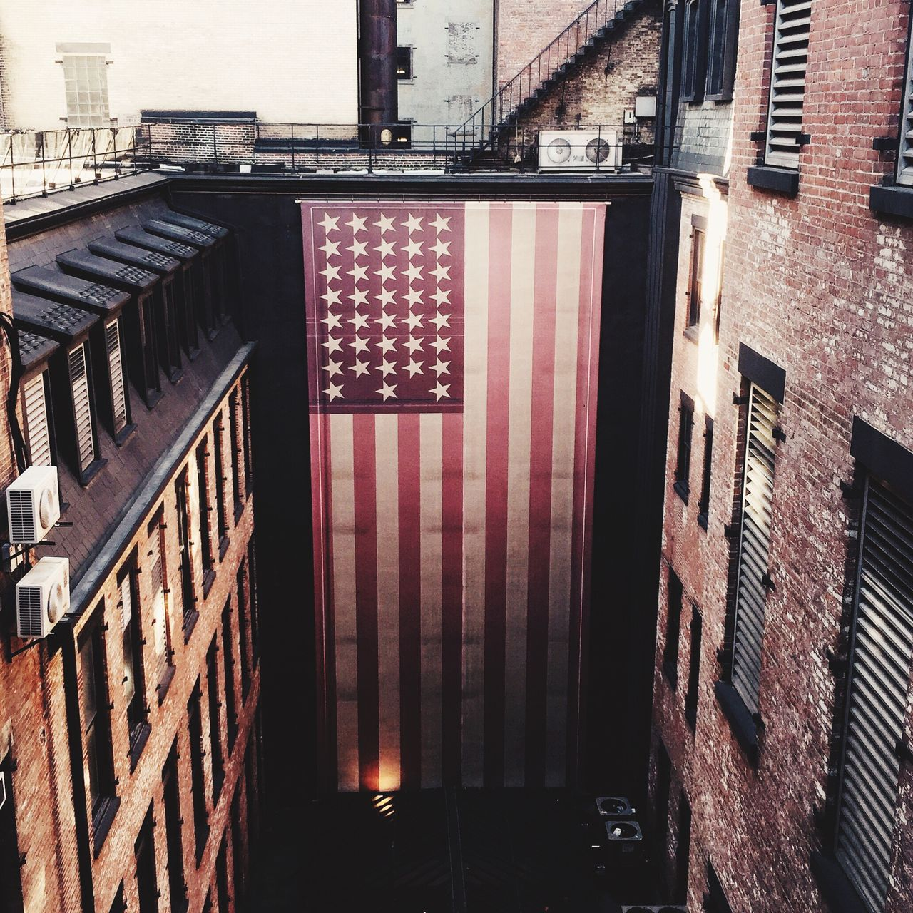 High angle view of american flag on building in city