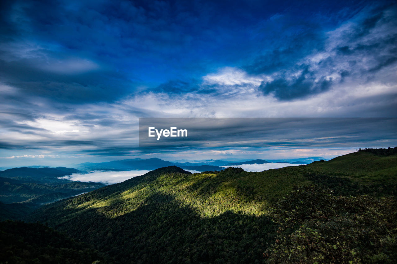 cloud - sky, scenics - nature, beauty in nature, tranquil scene, sky, tranquility, mountain, non-urban scene, environment, landscape, nature, no people, idyllic, mountain range, day, remote, outdoors, blue, travel