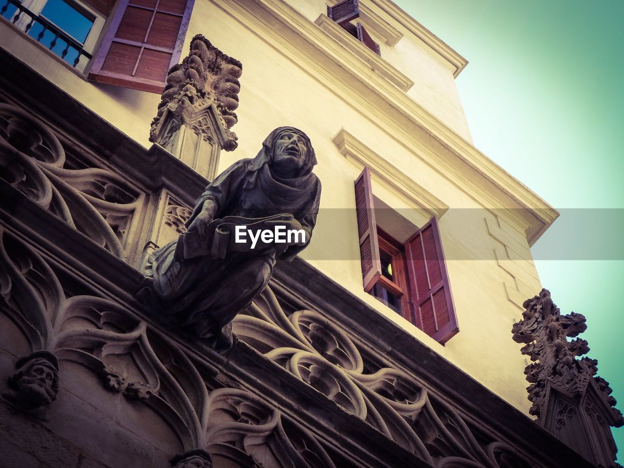 statue, low angle view, architecture, human representation, sculpture, building exterior, built structure, male likeness, art and craft, history, outdoors, no people, religion, spirituality, day, sky