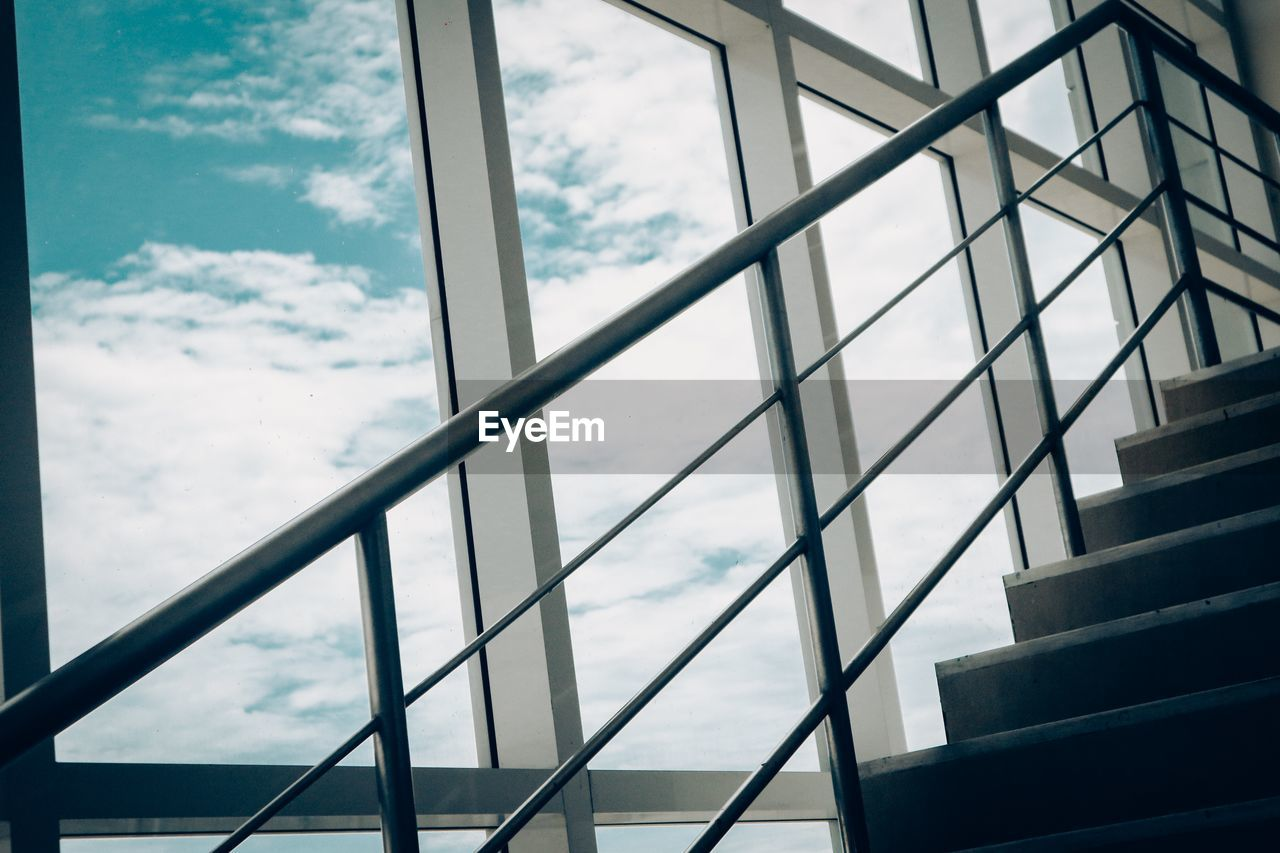 cloud - sky, architecture, built structure, sky, no people, day, glass - material, low angle view, railing, transparent, building exterior, nature, window, outdoors, staircase, pattern, building, metal, steps and staircases